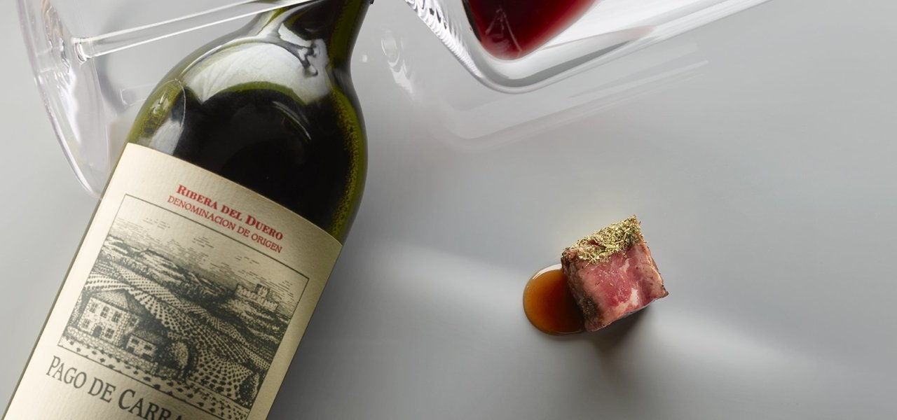 Wine bottle with gourmet food - Wine Paths